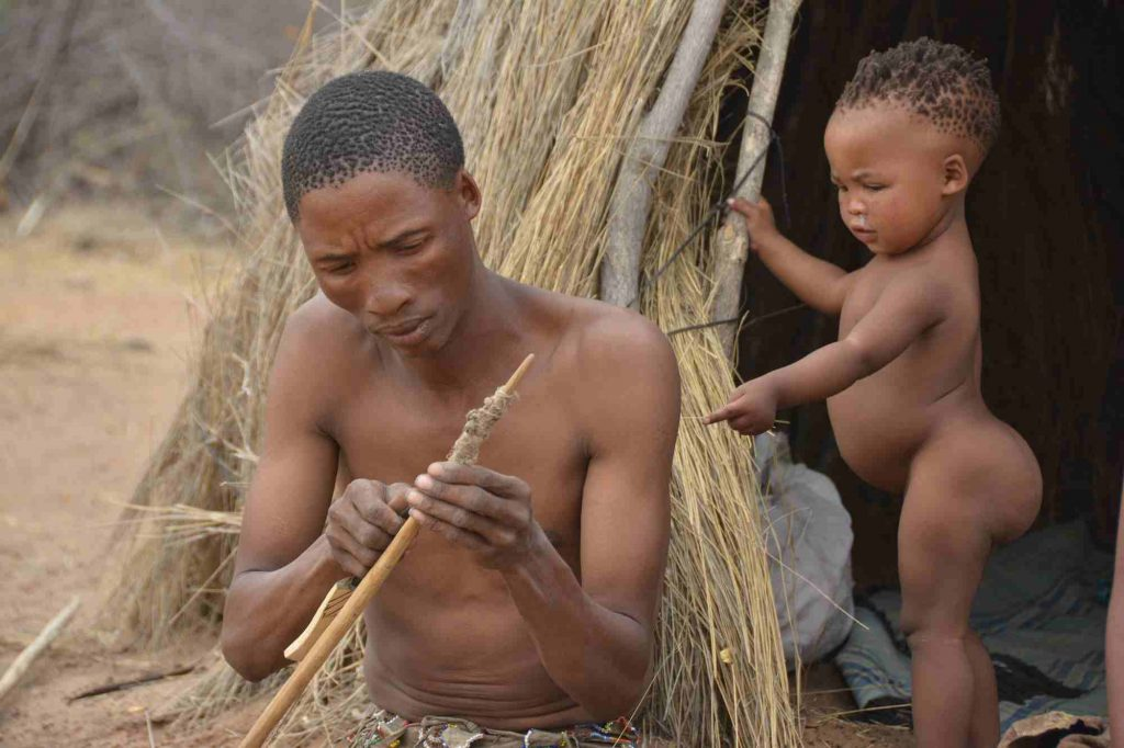 TUCSIN Tsumkwe Lodge - excursion to a village, man and child. Activities